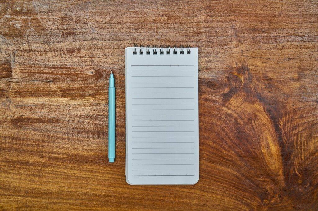 notebook, pen, 3 nackdelar med tidrapportering i app